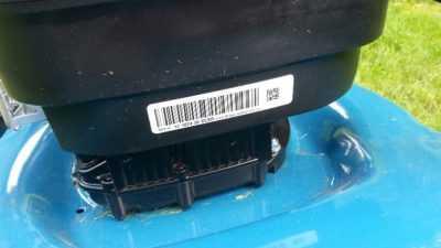 Etiket op grasmachine Codipack